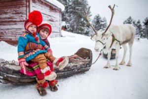 Sami children with reindeer