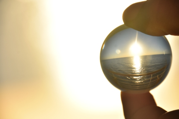 Sunset in the sea through a crystal ball